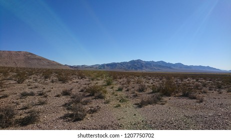 Desolate hilly desert landscape in Mojave near Rhyolite Ghost Town - Nevada