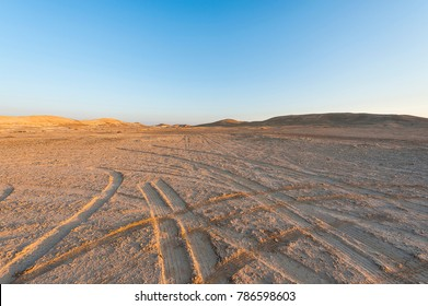Desolate infinity of the Rocky hills of the Negev Desert in Israel. Breathtaking landscape and nature of the Middle East.