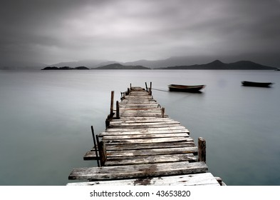 desolate pier and boat