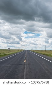 Desolate road under a cloudy sky