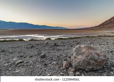 Desolated desert landscape of a dried up lake at dusk in Death Valley, California, US.