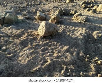 Desolating landscape. Surreal terrain. Absence of rain. Severe drought. Brown dry land. Lunar environment.