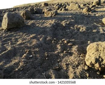 Desolating landscape. Surreal terrain. Absence of rain. Severe drought. Brown dry land. Lunar environment. Spain.