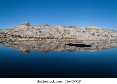 Desolation Wilderness.  The Crystal Range of the Sierra Nevada mountains reflected in Lake Aloha