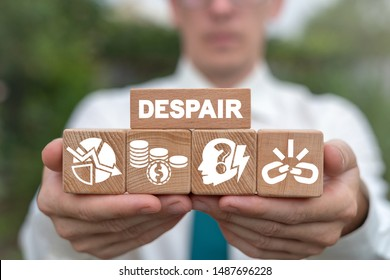 Despair Business Problem concept on wood blocks in businessman hands. Crysis or bankruptcy.