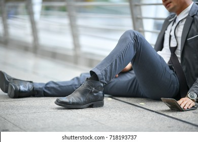 Despair and stress of failed man sitting on street way feel stressful.Unemployed businessman crisis stress and jobless waiting for new vacancies.Depressed situation and despair economic crisis concept