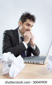 The despaired clerk has problems working with the laptop
