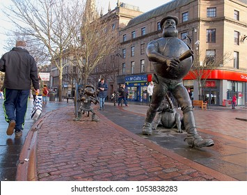 Desperate Dan and Beano Minnie in the center of Dundee.  Dundee, Scotland - January 27, 2018 Residents next to the monuments of Dan and Beano Minnie, figures of British comics in the center of Dundee.