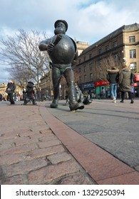 Desperate Dan and Beano Minnie in the center of Dundee.  Dundee, Scotland - 18 February 2019 Artistic statue of Desperate Dan and Beano Minnie, a British comic book character in the center of Dundee.