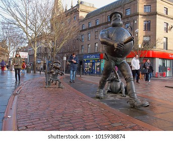 Desperate Dan and Beano Minnie.  Dundee, Scotland - January 27, 2018 Statue of Dan and Beano Minnie, heroes of British comics in the center of the Scottish city of Dundee.