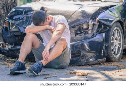 desperate man after car crash