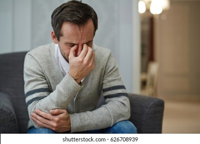 Desperate man crying during psychological session