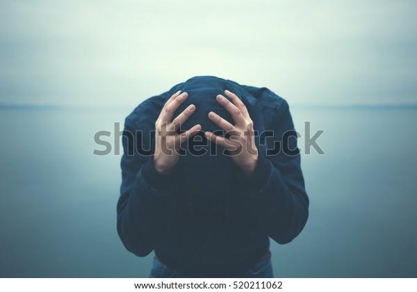 https://image.shutterstock.com/image-photo/desperate-man-holding-head-hands-600w-520211062.jpg