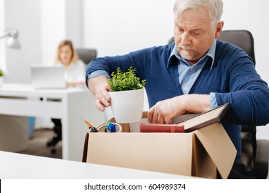 Desperate office manager gathering personal stuff into the box