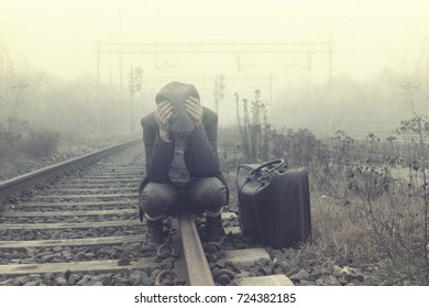 desperate person waits for the train to leave