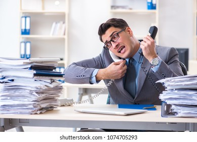 Desperate sad employee  tired at his desk in call center