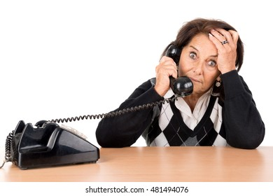 Desperate senior woman with telephone isolated in white