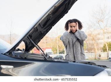 Desperate woman after checking her car broken engine