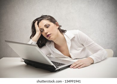 desperate woman with hands in her hair fixed laptop
