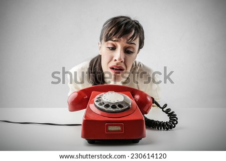 Desperate woman waiting for someone to call her