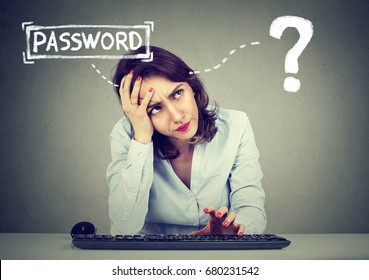 Desperate young woman trying to log into her computer forgot password