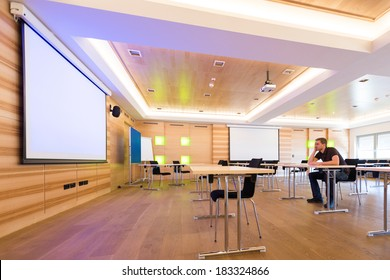 desperated man in conference room with white projection screen