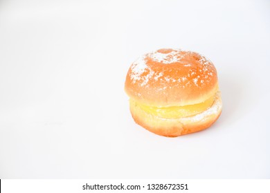 Dessert, Berline's donut with doughnut fried and cut on side shape as berger filling with vanila custard cream and top with icing sugar. Traditional German pastry , delicious dessert in europe.