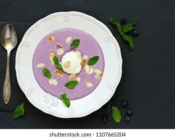 Dessert, blueberry soup with ice cream and mint.