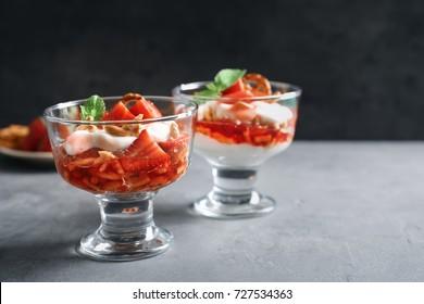 Dessert bowls with strawberry pretzel salad on table