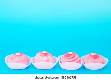 Dessert called 'Pia' or Mung bean filling cake, Pink bean and egg filling dessert on blue background