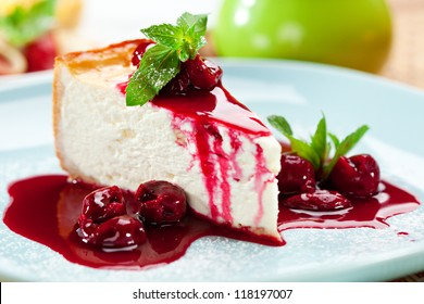 Dessert - Cheesecake with Berries Sauce and Green Mint