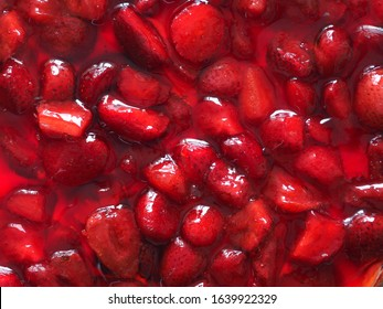 dessert - chopped strawberries in strawberry jelly as texture and background