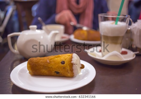 Dessert with coffee, tea and cakes in the cafe in evening time