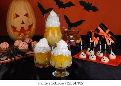 Dessert, cookies, chocolates on the table in honor of Halloween