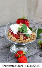 dessert in a glass of cookies, strawberries and cottage cheese