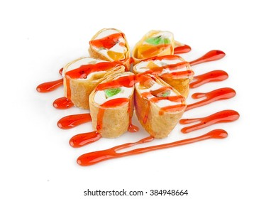 Dessert Maki Sushi - Roll with Various Fruit and Cream Cheese inside. Pancake outside. Served with Strawberries Sauce