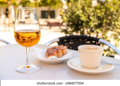 A dessert with Moscatel at a shady place in Portugal
