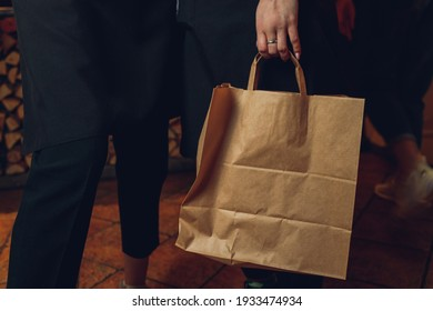 dessert paper bag waiting for customer on counter in modern cafe coffee shop, food delivery, cafe restaurant, takeaway food.
