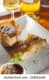 Dessert platter of creme brulee, nougat ice cream and apple tart paired with sweet wine.