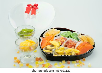 Dessert, preserved fruits in plastic heart shape container.