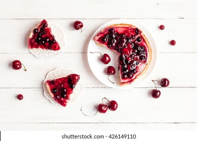 Dessert with red berries on wooden white background. Summer fruit dessert. Top view, flat lay