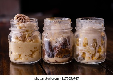 Dessert of sorbet and chocolate with caramel inside a glass jar.