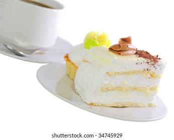 Dessert -sponge cakes  on white plate with  with cup of coffee.  Isolated.