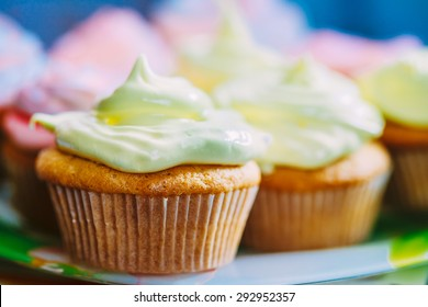 Dessert Sweet Gourmet Cupcakes With Multi-colored Frosting On Wooden Background