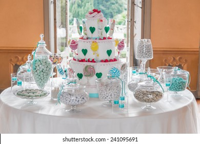 Dessert table with cake and candy on a wedding day