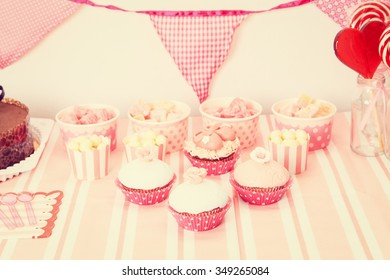 dessert table in pink served at girls birthday party