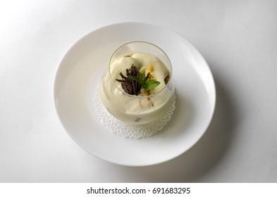 Dessert tiramisu with mint in a transparent glass