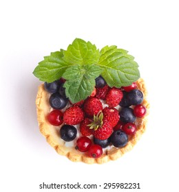 Dessert with wild berries.  Sweet tart with wild strawberry, blueberry and red currant.