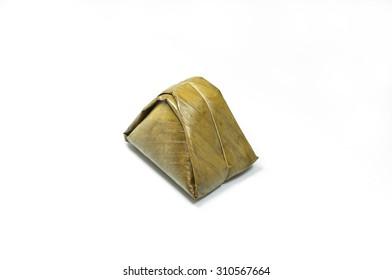 Dessert wrapped in banana leaves