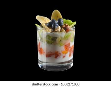 Dessert. Yogurt with oranges, grapefruit, kiwi, banana, nuts and blueberries. Isolate